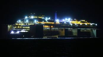 File The Costa Concordia wreckage in tow (Photo courtesy of the Parbuckling Project)