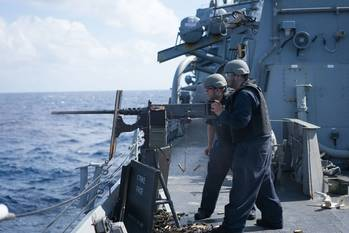 File Sailors aboard Arleigh Burke-class guided-missile destroyer USS Curtis Wilbur (DDG 54) fire a M2HB .50-caliber machine gun during a gunnery exercise in the South China Sea. Curtis Wilbur is on patrol in the 7th Fleet area of responsibility in support of security and stability in the Indo-Asia-Pacific region. (U.S. Navy photo by Lt.j.g. Jonathan Peterson/Released)