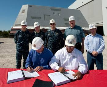 File Jonathan Graves (sitting, left) and John Fillmore (sitting, right) sign the delivery documents: Photo credit HII
