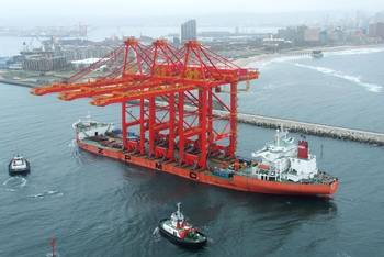 File Three mega-sized harbour cranes arriving in the Port of Durban onboard the Zhen Hua 27 vessel.  Photo by Roy Reed