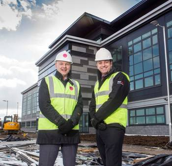 File Howard Crawshaw, director of Knight Property Group, and Bibby Offshore's chief executive Howard Woodcock outside Bibby's new HQ in Westhill