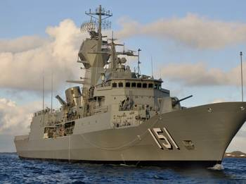 File HMAS Arunta on her first day at sea conducting a boat transfer (Australia Department of Defense photo)