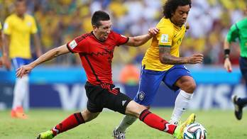 File Marcelo of Brazil is challenged by Hector Herrera of Mexico (Photo courtesy of FIFA)