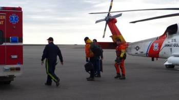 File A man suffering from a head injury walks toward an ambulance after being medevaced from a South Korean icebreaker by a Coast Guard MH-60 Jayhawk helicopter crew to Barrow, Alaska, Aug. 20, 2014. (USCG photo)