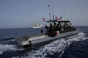 File A patrol boat manned by members of Port Security Unit 311 deployed to Joint Task Force-Guantanamo Bay, Cuba, escorts the Coast Guard Cutter Eagle as it sails into Naval Base Guantanamo Bay, June 7, 2013. (U.S. Coast Guard photo by Petty Officer 2nd Class Steven Bolz)