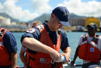 File Coast Guard National Strike Force samples water in Honolulu Harbor