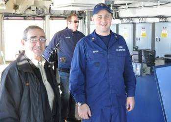 File Petty Officer 1st Class Zachary Rafoth, a damage controlman aboard Coast Guard Cutter Mackinaw, gives a tour of the Mackinaw