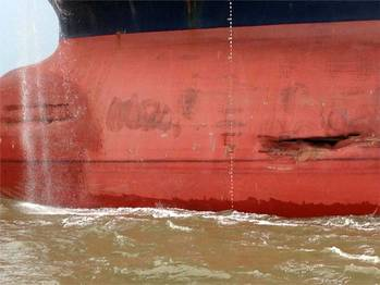 File The unloaded 800-foot tanker, Minerva Maya, sustained some damage after a collision with a tug pushing barges in the Houston Ship Channel June 2, 2013. No injury or pollution was reported from the incident. U.S Coast Guard Photo.