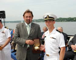 File Ensign Jeffrey Iiams receives the Elmer A. Sperry Junior Navigator of the Year Award from Jeff Holloway of Northrop Grumman Corporation.