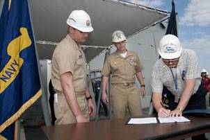 File ith U.S. Navy Capt. Bill Galinis, supervisor of shipbuilding, Gulf Coast, far left and U.S. Navy Cmdr. Thomas R. Williams, DDG 110