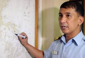 File The Philippine coastguard spokesman points to the area on a map where a ferry went down on June 14, 2013 (AFP/File, Jay Directo)