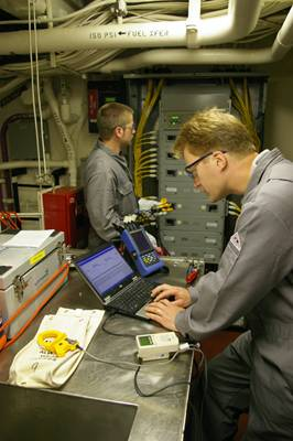 File Alaris engineers perform an audit of energy use aboard a U.S. Coast Guard Cutter.