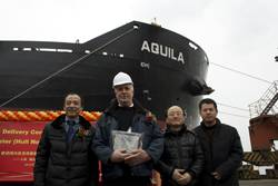 File Delivery of M.V. Aquila: Left to right: Mr. Zhuang Tian, LR Surveyor in Charge Nantong; Master - M/V Aquila; Mr. Tae-Bok Kwak, LR Project Manager; Mr. Xiaofeng Yang, LR Site Office Team Leader.