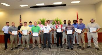 File Austal USA honored 15 graduates of Austal's cutting-edge four-year apprenticeship program.
