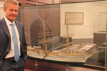 File Shipyard boss Dr. Herbert Aly in Front of the German Navy sail training ship Gorch Fock where he was a crew member during his naval service.
