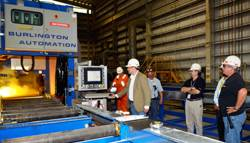 File Executives from the two companies gathered this week at the BAE Systems Mobile shipyard to oversee the initial cutting of steel.