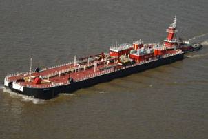 File Bouchard's B. No. 264 and tug Evening Tide navigate down the Mississippi River delivering the barge's first load of cargo. Photo courtesy Bollinger Marine Fabricators, L.L.C.