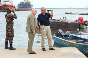File William H. Watson, president of AdvanFort International, center, surveys the Port of Cotonou with Ric Hedlund, AdvanFort