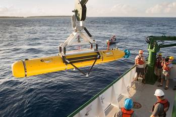 File The team aboard the K-O-K research vessel prepare the Bluefin Robotics AUV for deployment. The vehicle was equipped with a Ranger 2 tracking transponder, visible towards the rear of the AUV