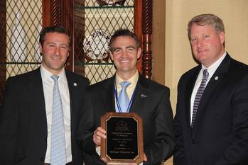 File Chris Bollinger, Executive VP of Bollinger Shipyards, Inc., (center) accepts the 2102 Award for Excellence in Safety from SCA Manager Government Affairs, Ian Bennitt (left), and SCA President, Matthew Paxton.