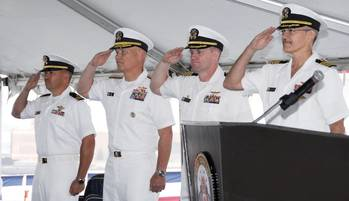 File (Left to right) Navy Lt. Harlan Kimball, Comfort chaplain; Navy Rear Adm. Mark H. Buzby, commander, Military Sealift Command; Navy Capt. David K. Weiss, U.S. Navy Medical Corps; and Navy Capt. Kevin J. Knoop, commanding offer, Medical Treatment Facility, USNS Comfort, participate in Military Sealift Command hospital ship USNS Comfort