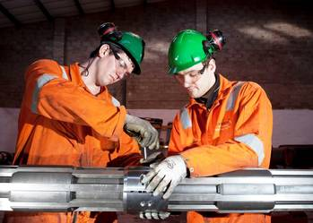 File Onshore Technician, Lewis Brake (L) and Ian Spence, Onshore Supervisor (R) working on a Coretrax SP superior performance magnet.