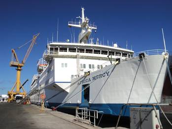 File Africa Mercy alongside at a repair berth in Astican Shipyard, Las Palmas, Gran Canaria for brief annual upkeep period of repairs and modernization.  (Photo credit: © Mercy Ships/Ann Berry)