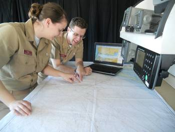 File Texas A&M students, Holly Ball and Nicholas Mogensen, seniors in the Marine Transportation Department, train with Rose Point Navigation ECS software on the bridge of the academy ship, General Rudder.