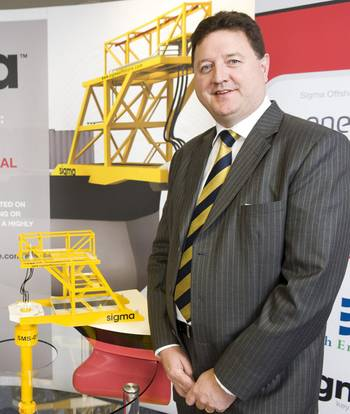 File Alistair Dornan, President and Chief Executive Officer of Sigma Offshore, next to a scale model of the company's SMS innovation (Photo: Sigma Offshore).