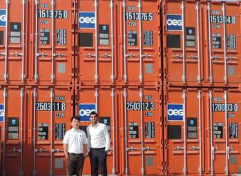 File Daniel Lim and Sahil Gandhi (L to R) in front of a line of OEG Containers