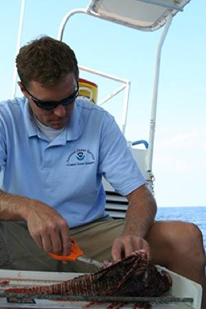 File Dr. James Morris & Lionfish: Photo credit NOAA