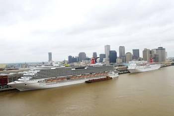 File The 3,646-passenger Carnival Dream (left) and the Carnival Elation are pictured berthed at the Port