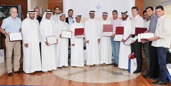 File Amer Ali, Executive Director, Dubai Maritime City Authority, among marine driver's license holders with senior officials in DMCA during the ceremony at DMCA headquarters.