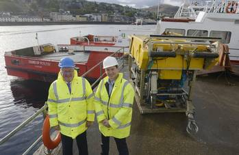 File Energy Minister, Fergus Ewing (left), is pictured in front of one of The Underwater Centre's new vessels and work-class ROV, with the Center's General Manager, Steve Ham.