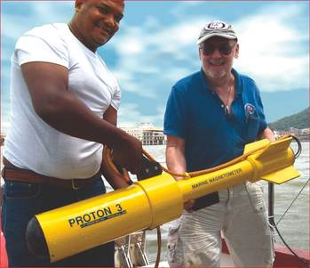 File Russell Bennett (r) prepares to survey for shipwreck sites in Panama's old harbor area with his JW Fishers Proton magnetometer. Presidential Palace is visible in the background between the two men.