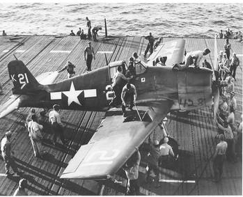 File Flight Deck Crew Swarm Over an F6F Hellcat - July 1944. (Photo: U.S. Navy's National Museum of Naval Aviation, Pensacola, Fla.)