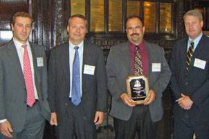 File Gladding-Hearn Shipbuilding officials accept 2009 Improvement in Safety Award from the Shipbuilders Council of America in April (left to right): Ian Bennitt, SCA manager of government affairs, Peter Duclos, Gladding-Hearn president, Paul Simons, Gladding-Hearn's safety and compliance coordinator, and Matt Paxton, SCA president.