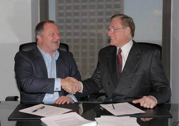 File Shane J. Guidry, Chairman & CEO, Harvey Gulf (left) and J. Barry Snyder, President, Signet Maritime sign closing documents on May 15 at Harvey Gulf International Marine in New Orleans, Louisiana for the sale of Harvey's Offshore Towing Division to Signet Maritime.