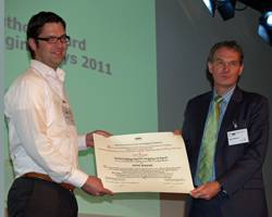 File Bas Borsje (left) receives the IADC Award for the Best Paper by a Young Author from IADC Secretary General René Kolman at CEDA Dredging Days, November 11, 2011.