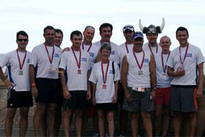 File Team W&O at the completion of the race: Art Parrish, Jack Guidry, Mike Page, Collin Luke, Carl Herman, Peter Osterman (back), Sandy White (in front of Peter), Steve Stafford, Alex Piquer, Kyle Posey (in horns), Lisa Collins, Rogier Blokdijk.