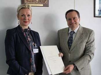 File First Secretary Kristin Stockman of the Royal Norwegian Embassy to the United Kingdom, hands over Norway's instrument of accession to the  Hong Kong International Convention for the Safe and Environmentally Sound Recycling of Ships, 2009, to Mr. Gaetano Librando, Head, Legal  Affairs Office, Senior Deputy Director, Legal Affairs and External Relations Division, IMO