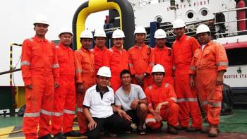 File Survivor With Rescuers: Photo credit Swiber Holdings
