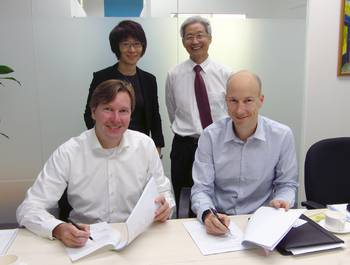 File Willem Buijs, CEO Hatenboer Water BV and Guy Heijnen, Managing Director of Hatenboer-Water Asia Pte. Ltd., placing their signatures, watched by Mrs. Yeoh en Mr. Lim of Corporate Alliance