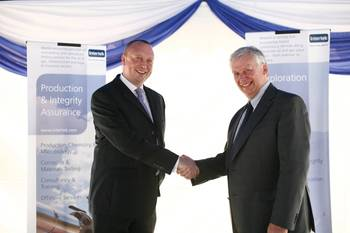 File Dr. Tom Whitfield, manager of E&P for South East Asia at Intertek with Raymond Pirie, vice president of Intertek