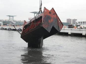 File Donjon Marine dredges New York Harbor for the return and  re-entry of the USS Intrepid, a museum and educational center.
