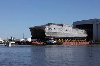 File JHSV 4 rolls out of Austal final assembly on Berard Transportation transporters onto a launch barge (photo: Austal)