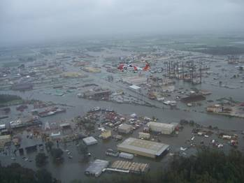 File Coast Guard Jayhawk 6031 from Air Station Elizabeth City, N.C. flys over flooded areas in New Iberia, La., Sunday, Sept. 14, 2008. Coast Guard helicopter crews began flying over flooded areas looking for signs of people in distress after Hurricane Ike reached the Gulf Coast causing tremedous devastation to many areas in Louisana and Texas.  Photo credit:  USCG