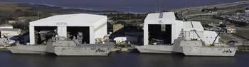 File File Photo: LCS hulls 4 & 6 alongside the pier at Austal Shipyard..