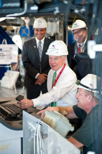 File U.S. Senator Jeff Sessions assists with completing the Combat Systems Light Off.