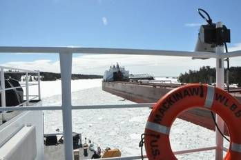 File The Cutter Mackinaw comes ahead and creates a track through the ice for the motor vessel James R. Barker (which had become stuck in brash ice) to follow in the vicinity of the Johnson Point Turn in the lower St. Marys River. Photo: USCG